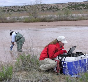 Pueblo of Santa Ana members measure water quality under the tribe's extensive water-monitoring program, recently certified as autonomous under the Clean Air Act by the U.S. Environmental Protection Agency. Read more at http://indiancountrytodaymedianetwork.com/2015/07/22/santa-ana-pueblo-get-epa-certified-administer-clean-water-act-tribal-land-161159