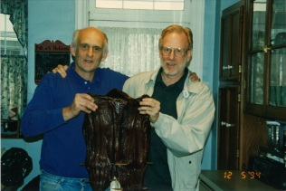 Harry Sachse and Reid Chambers display a salmon given by the Colville Tribes in celebration of Grand Coulee settlement, Autumn 1994
